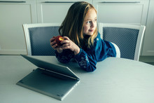 Girl Leaning On Table By Laptop