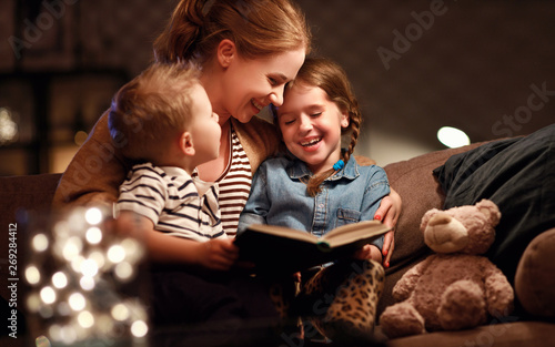 Obraz evening family reading. mother reads children . book before going to bed - fototapety do salonu