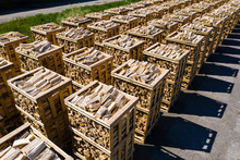 Rows Of Firewood Stacked On Pa...