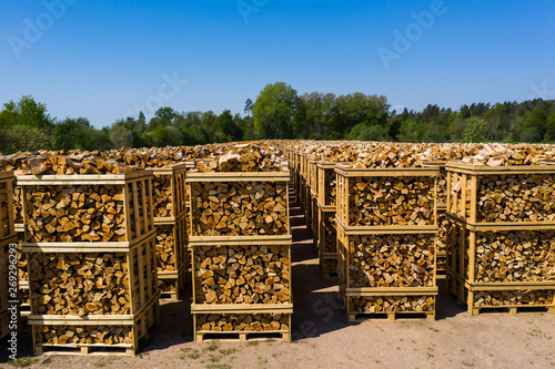 Rows of firewood stacked on pallets ready for transport Fototapeta