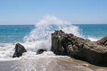 Waves Crashing On Rocks In Sycamore Beach, California