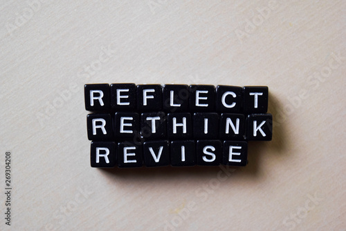 Photo Reflect - Rethink - Revise on wooden blocks
