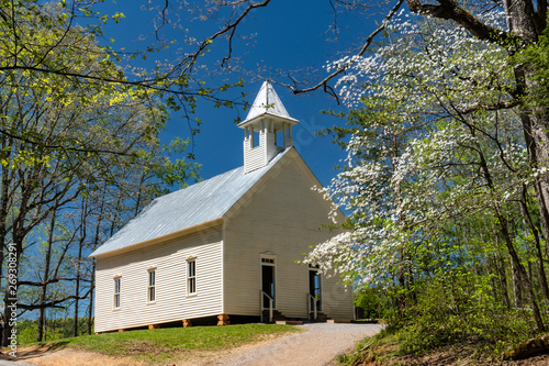 Little white church in the Smokies surrounded with Dogwood blooms.