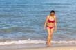 Woman with bikini pink relax on beach