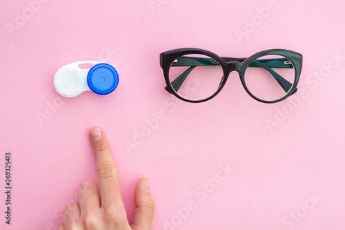 Obraz Choose between glasses and contact lenses because of poor, blurred vision and myopia. Eye care - fototapety do salonu