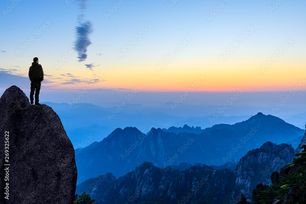 Fototapety, obrazy: Man on top of mountain,conceptual scene