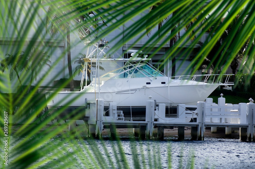 Close up parked boat at dock on canal in Florida, USA Slika na platnu