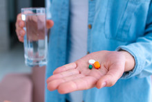 Medicine Woman Taking Pills And Vitamins For Wellness At Home. Health Care And Treatment Diseases.