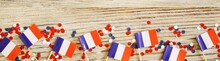 The National Holiday Of July 14 Is A Happy Independence Day Of France, Bastille Day, The Concept Of Patriotism, Memory, Place For Text, Confetti And Flags On A Wooden Table, Horizontal