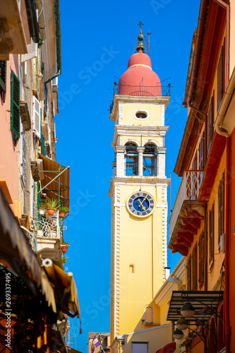 Foto  Street and the bell tower of the church of Saint Spyridon in Corfu, Greece