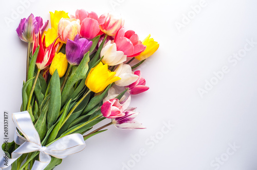 Pinturas sobre lienzo  bright spring bouquet of multi-colored tulips on a white background