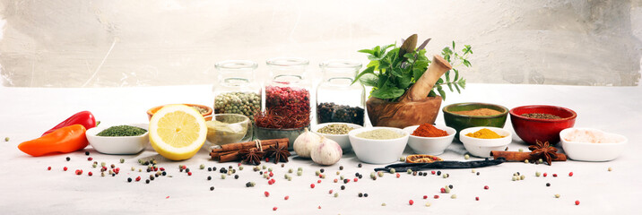 Spices and herbs on table. ...