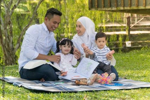 Fotomural  Malay family at recreational park having fun