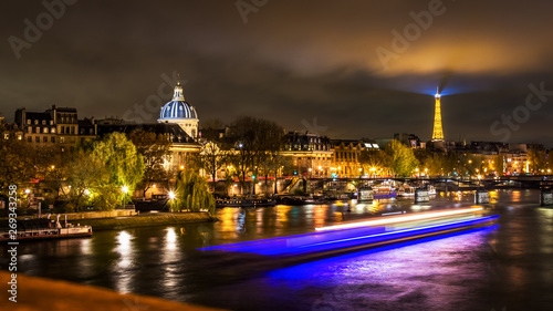 Night cityscape scene in Paris over the Seine river with the Eiffel Tower in bac Canvas Print