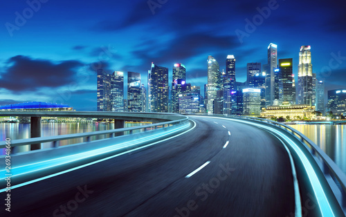 Spoed Fotobehang Nacht snelweg Highway overpass modern Singapore city skyline background . Night scene .