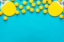 Two Rackets And Many Balls For Table Tennis On Turquoise Blue Background. Flat Lay Image Of Many Table Tennis Balls And Paddles. Minimalist Photo Of Yellow Ping-pong Equipment With Copy Space