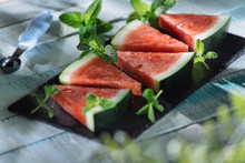 Slices Of Watermelons On White Wooden Table