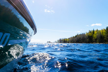 Side View Speeding Fishing Motor Boat With Drops Of Water. Blue Ocean Sea Water Wave Reflections With Fast Fishing Yacht. Motor Boat In The Blue Ocean. Ocean Yacht. Sunset At The Sailboat Deck