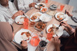 top view of hand eating in dinner table together with family