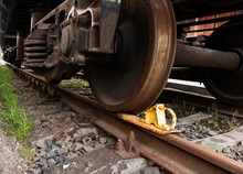 A Closeup View Of The Wheels Of A Train Wagon