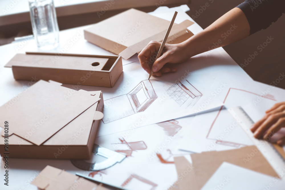 Fototapety, obrazy: Designer draws a mockup for crafting cardboard box. Development of packaging design sketch.