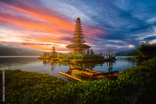 Pura Ulun Danu Bratan, Hindu temple with boat on Bratan lake landscape at sunset in Bali, Indonesia.