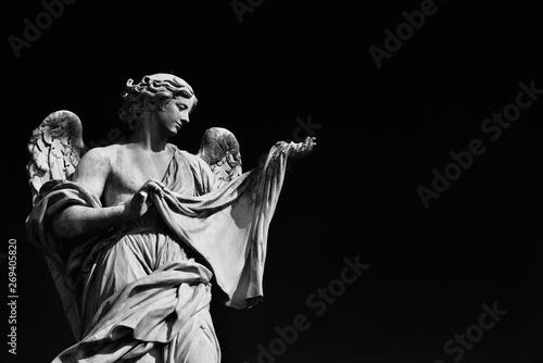 Valokuvatapetti Angel statue holding the Holy Veil