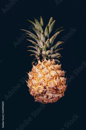 Fototapety, obrazy: pineapple old color on a black background