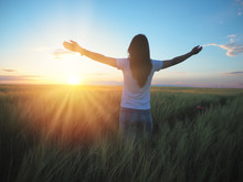 Woman Feeling Free In A Beautiful Natural Setting, In What Field At Sunset