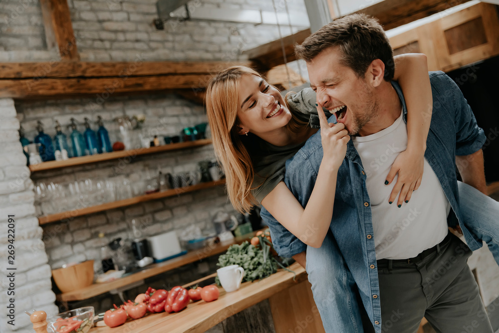 Fototapety, obrazy: Lovely couple having fun together at rustic kitchen