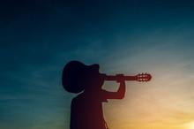 Silhouette Of A Guitarist In T...