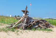Beach Driftwood Sculpture Erected On Sand Dune.