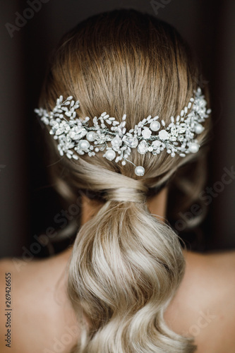 Elegant bride hairstyle. Bridal accessory, bridal hairstyle. Look from back