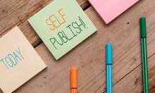 Text Sign Showing Self Publish. Business Photo Showcasing Writer Publish Piece Of Ones Work Independently At Own Expense Note Papers And Stationary Placed Sideways On Top Of Softhued Backdrop