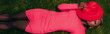 Leinwandbild Motiv top view of elegant african american woman in pink dress lying with hat on green grass