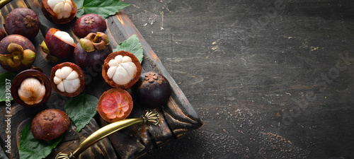 Tropical fruits, Mangosteen on a wooden background. Top view. Free space for text. - 269439037