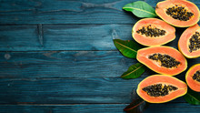 Tropical Fruits, Sweet Papaya, Raw Vegan Food On A Blue Wooden Background. Top View. Free Space For Text.