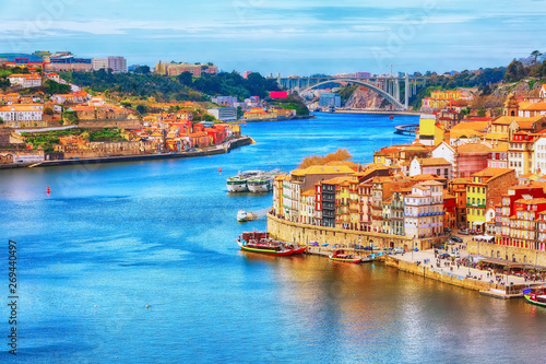 Poster Piscine Porto, Portugal old town ribeira aerial promenade view with colorful houses, Douro river and boats
