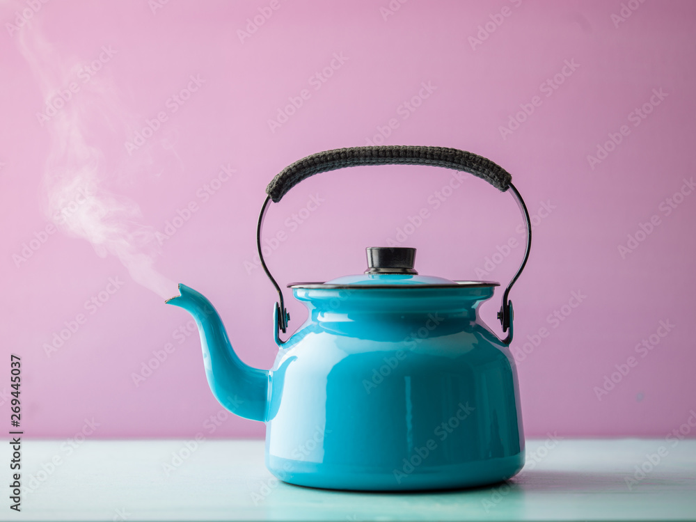 Fototapety, obrazy: Steaming kettle with boiling water against pink background