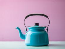 Tea Kettle Against Pink Background