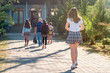 Group of kids going to school together, back to school