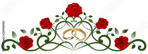 Valokuva  decorazione con anelli nuziali intrecciati e rose rosse