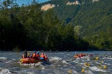Rafting In A Big Boat On A Rough Mountain River In Summer