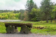 A Wooden Bench To Rest On As You Walk Around Bass Lake In Blowing Rock, North Carolina.