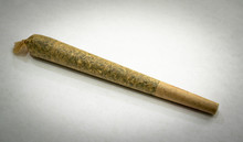 "A Pre-rolled Joint Of The Cannabis Strain ""Primus"" On A White Background"