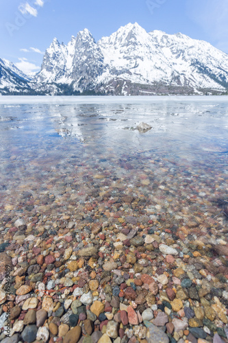 Fotografia, Obraz Lake rocks below a thin layer of ice in Jenny Lake, Grand Teton National Park, Wyoming