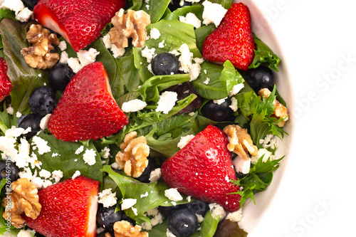 Bright Garden Salad With Fresh Fruit Isolated On A White