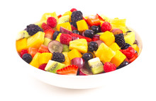 Bowl Of Rainbow Colored Fruit Salad Isolated On A White Background