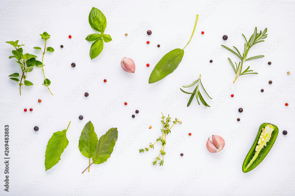 Fototapety, obrazy: Flat lay spices ingredients chili ,peppercorn, rosemarry, thyme,star anise ,sage leaves and sweet basil on wooden.