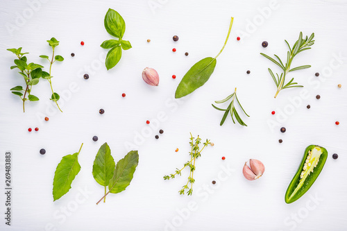 Fotografie, Obraz  Flat lay spices ingredients chili ,peppercorn, rosemarry, thyme,star anise ,sage leaves and sweet basil on wooden
